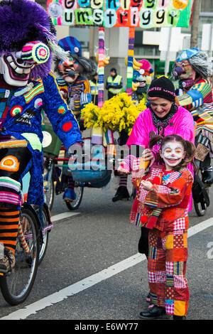 Little girl dressed up as a clown at the carnival procession, Carnival of Basel, canton of Basel, Switzerland Stock Photo