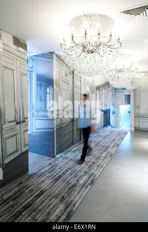 Man walking along a hotel corridor, Paris, France - Stock Photo
