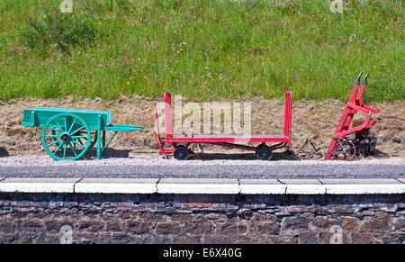Vintage railway equipment on display on the platform at Boat of Garten station, Strathspey Steam Railway, Speyside, - Stock Photo