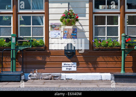 Amusing sign 'Water for steamed up dogs' at Boat of Garten station, Strathspey Steam Railway, near Aviemore, Cairngorms - Stock Photo