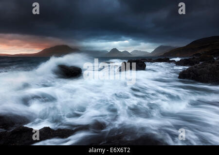 Rampaging surf at the beach of Elgol with the view to Cuillin Hills on the Isle of Skye, Scotland, United Kingdom - Stock Photo
