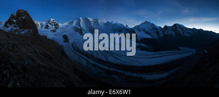 View above the imposing Pers Glacier in the blue light of the incipient night with first stars showing up over the - Stock Photo