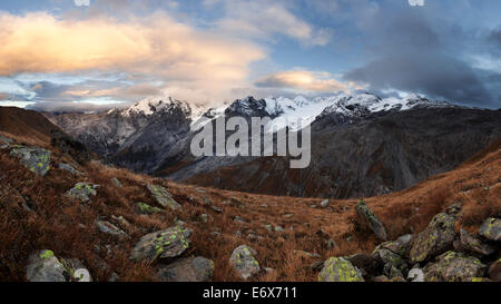 An impressive panorama of the Ortler Alps from a mountain meadow above the Stelvio Pass on an autumn evening, South - Stock Photo