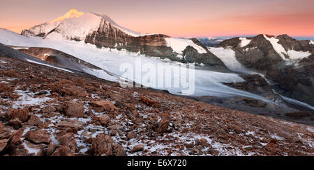 View from Barrhorn to the sunrise above the Brunegg Glacier and the peaks of the Weisshorn Mountain Range in autumn, - Stock Photo