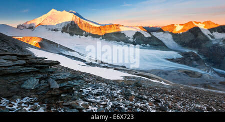 View from Barrhorn to sunrise above the Brunegg Glacier and the peaks of the Weisshorn Mountain Range in autumn, - Stock Photo