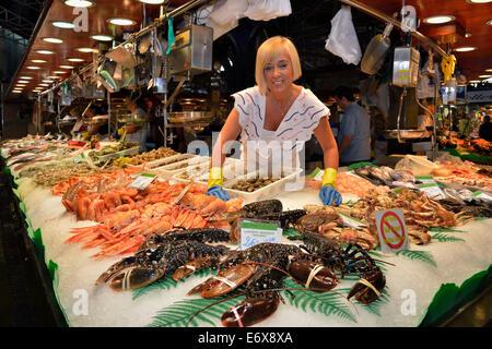 Fishmonger at her stall in the market hall, Mercat de la Boquería, also Mercat de Sant Josep, Barcelona, Catalonia, - Stock Photo