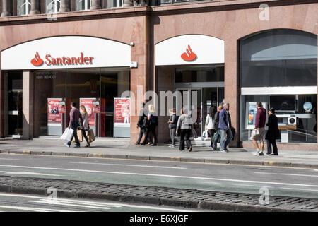 Shoppers walking past Santander Bank on Princes Street, Edinburgh - Stock Photo