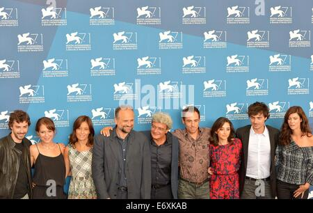 Venice, Italy. 1st Sept, 2014. Director Mario Martone (C) and cast members pose during the photo call for 'Il giovane - Stock Photo