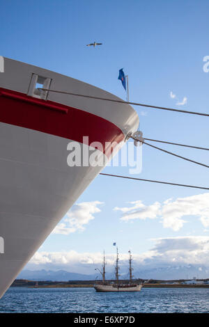 Bow of cruise ship MS Deutschland (Reederei Peter Deilmann) and sailing ship SV Europa in the harbor, Ushuaia, Tierra - Stock Photo
