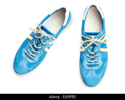 A pair of ladies' new blue lace-up trainer style casual walking shoes sneakers cut-out and isolated on a white background - Stock Photo