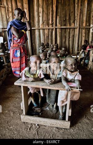 Children and teacher in a Massai village school, Kenya, Africa - Stock Photo
