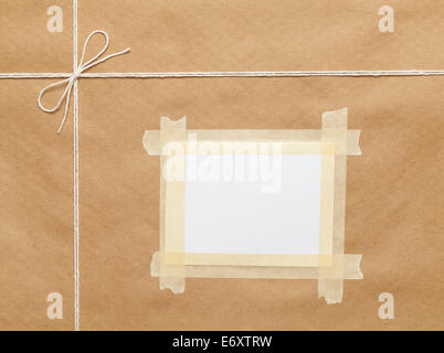 Brown Wrapped Package  with String And Copy Space. - Stock Photo