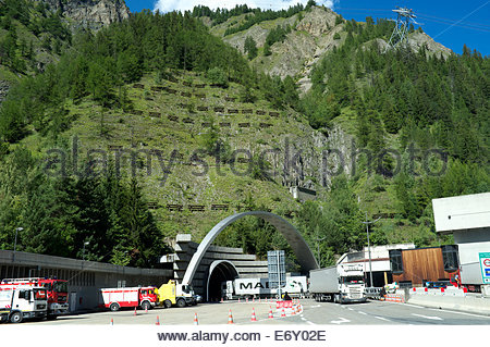 A truck enters as another exits the Mont Blanc Tunnel, on the Italian side. Italy, 2014. - Stock Photo