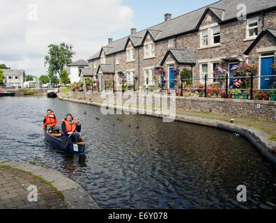 Brecon basin on the Monmouthshire & Brecon Canal (Mon & Brec) with the two young people in a canoe - Stock Photo