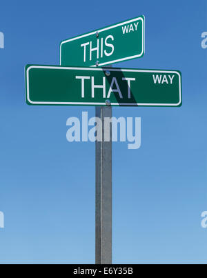 This Way and That Way Street Signs with Blue Sky Background. - Stock Photo