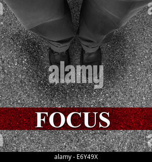 Businessman standing on asphalt starting line with motivation word of Focus - Stock Photo