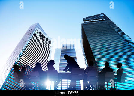 Silhouettes of Business People Meeting Outdoors - Stock Photo