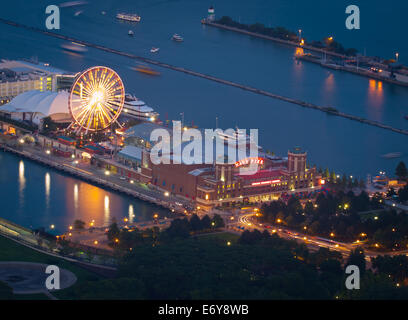 An aerial, night view of Navy Pier as seen from 360 CHICAGO (formerly the John Hancock Observatory). Chicago, Illinois. - Stock Photo
