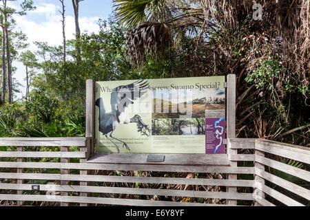 Informational signage along boardwalk leading to Corkscrew Swamp Sanctuary's Blair Audubon Center. - Stock Photo