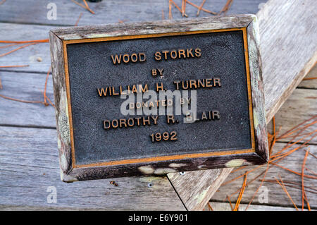 Brass plaque commemorates sculpture by William Turner titled 'Wood Storks' at Audubon Corkscrew Swamp Sanctuary - Stock Photo