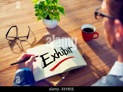 Man with Note Pad and Exhibit Concept - Stock Photo