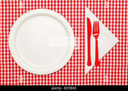 Paper Plate on Checkered Table Cloth wtih Plastic Utnesils and Napkin. - Stock Photo