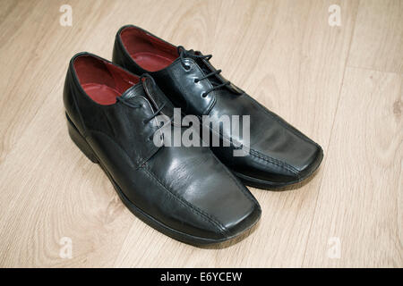 Pair of men's black leather shoes - Stock Photo