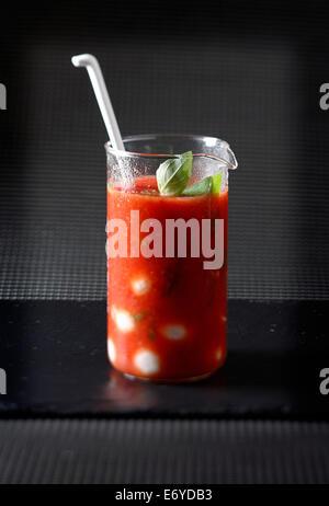 Tomato juice with basil - Stock Photo