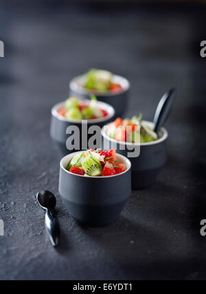 Kiwis and strawberries marinated in mint - Stock Photo