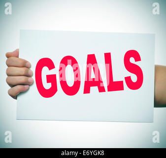 man hand holding a signboard with the word goals written in it - Stock Photo