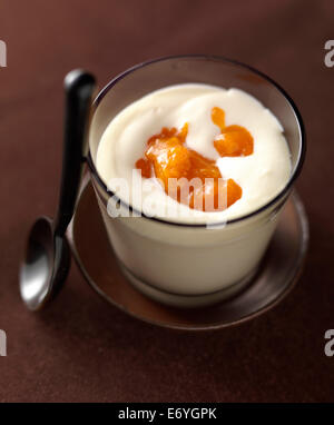White chocolate mousse with apricot jam - Stock Photo