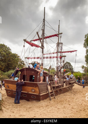 children playing on the pirate ship Diana's memorial playground kensington gardens london on an overcast cloudy - Stock Photo