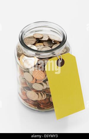 Savings Jar with tag - Stock Photo