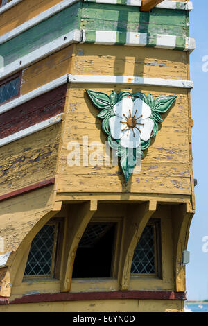 A carved Blossom of Hawthorne, or English Mayflower, carved on the stern of the Mayflower II in Plymouth Harbor, - Stock Photo