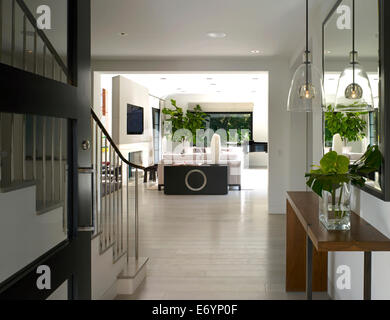 Open plan entrance hallway and living room in Stone House, Atherton, California, USA. - Stock Photo