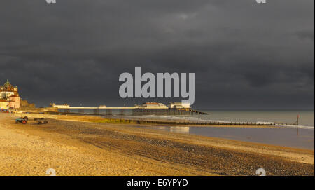 Cromer Pier and beach at sunrise in Summer in Norfolk England UK - Stock Photo