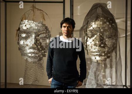 London, UK. 2nd Sept, 2014. Artist Xavier Mascaró poses next to his works 'Masks'. Xavier Mascaró's first UK solo - Stock Photo