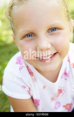Portrait of little girl outdoors - Stock Photo