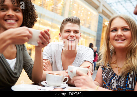 Group Of Young Friends Meeting In Café - Stock Photo