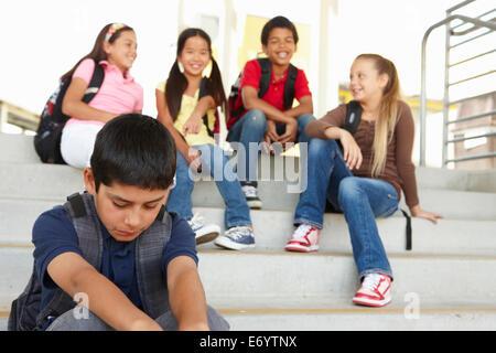 Boy being bullied in school - Stock Photo