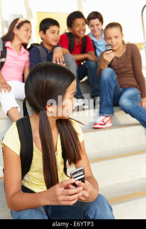 Girl being bullied in school - Stock Photo