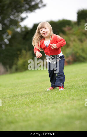 3 year old girl with Downs Syndrome - Stock Photo