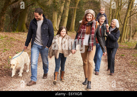 Couple Taking Dog For Walk On City Street - Stock Photo