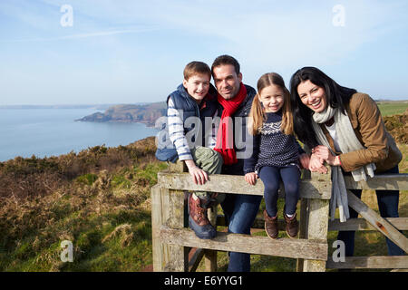 Portrait Of Family Walking Along Coastal Path - Stock Photo