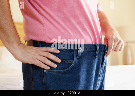 Close Up Of Man On Diet Losing Weight From Waist - Stock Photo