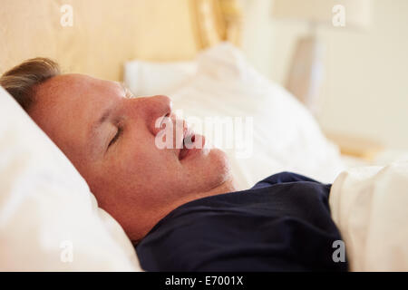 Overweight Man Asleep In Bed Snoring - Stock Photo