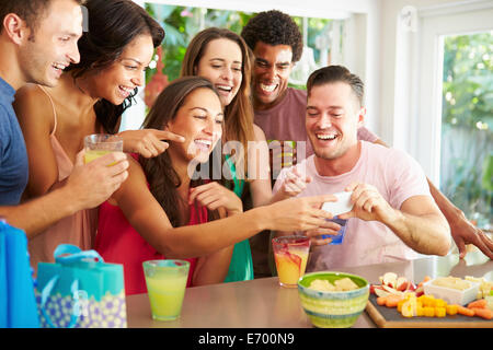 Group Of Friends Taking Selfie Whilst Celebrating Birthday - Stock Photo