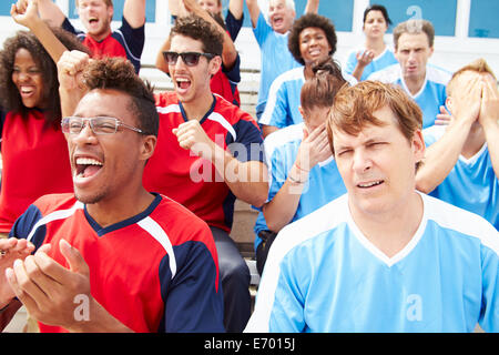 Rival Spectators Watching Sports Event - Stock Photo