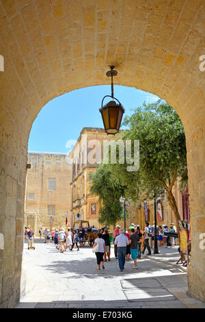 Entrance arch at the City gate at the Silent City of Mdina framing view of inner town streets free of almost all vehicles
