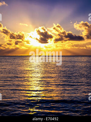 Sunrise and clouds over Caribbean sea, Guadeloupe, French West Indies - Stock Photo